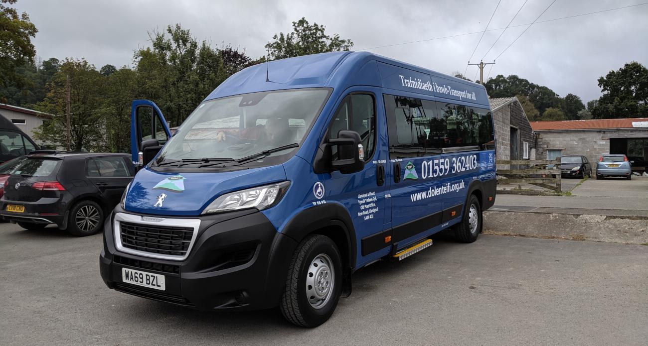 Front view of a blue Dolen Teifi minibus.